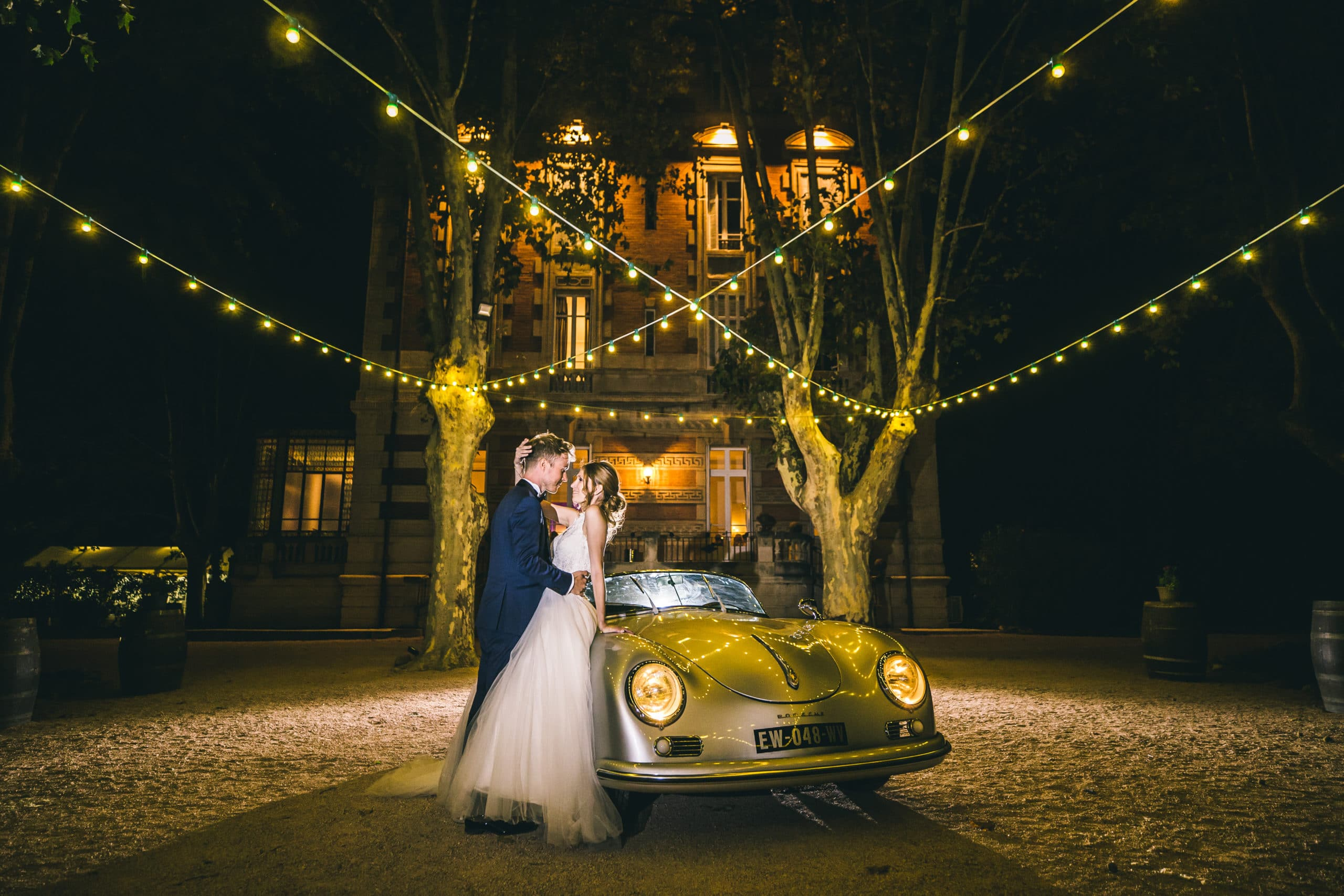 bride-groom-couple-porsche-car-lights-wedding-chateau-venue-reception-south-france-provence-magic